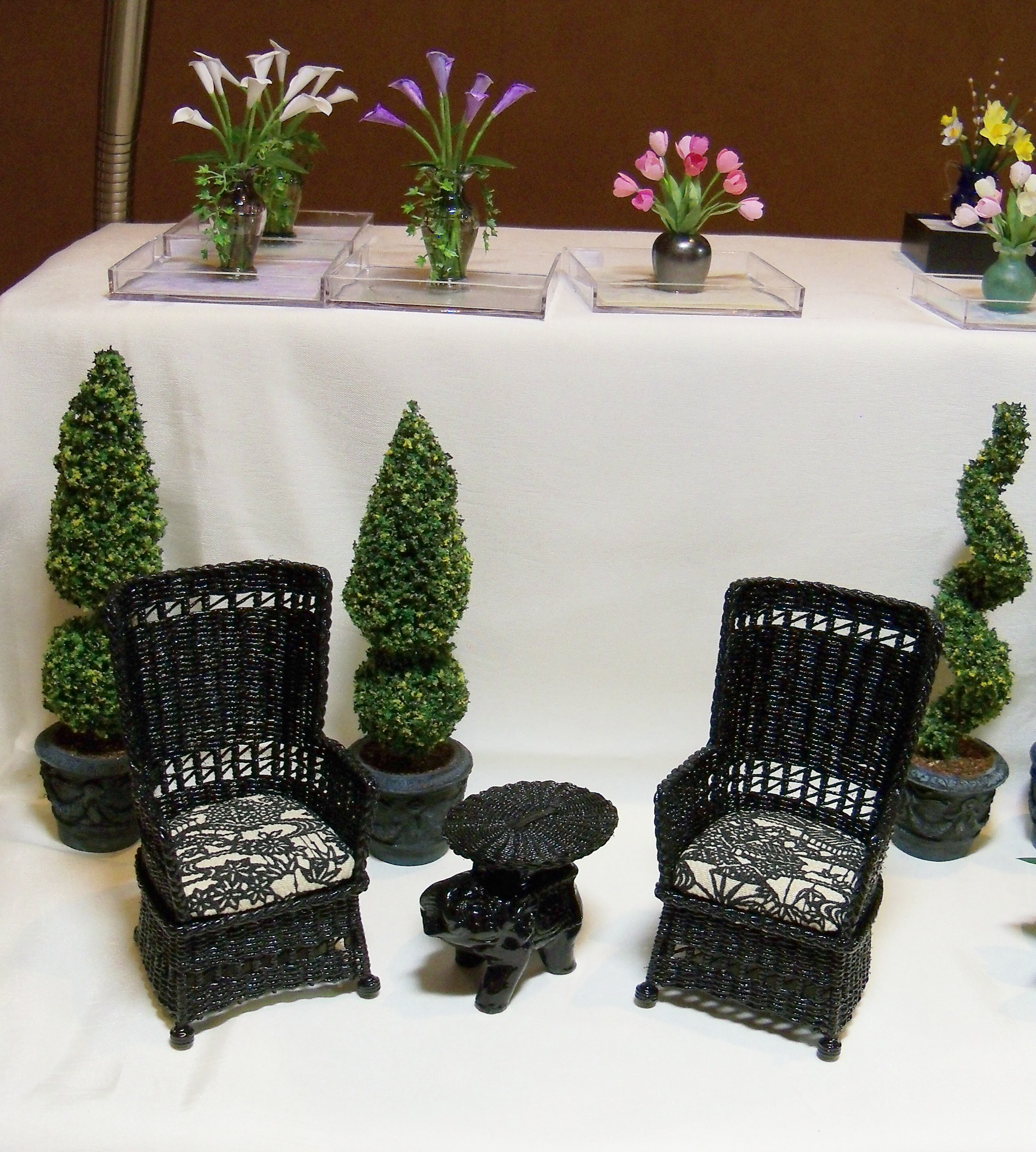 Black wing chairs and elephant table
