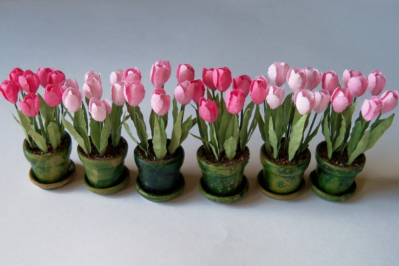 Assorted tulips in flower pots