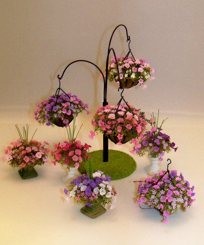 Petunias in baskets and urns