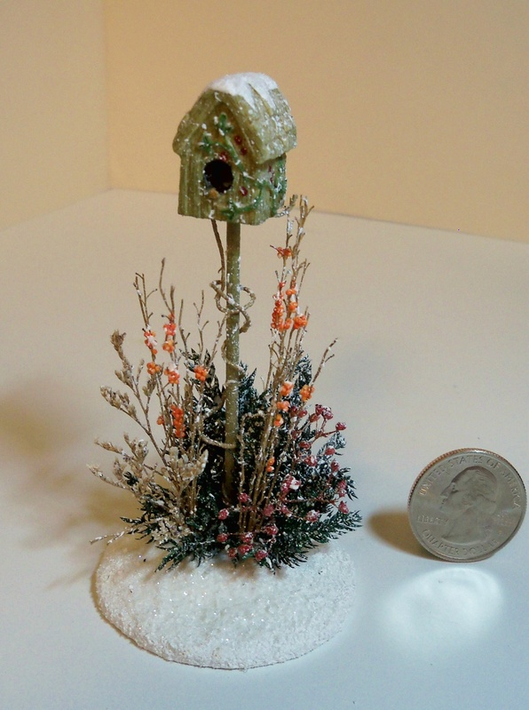 Winter birdhouse scene