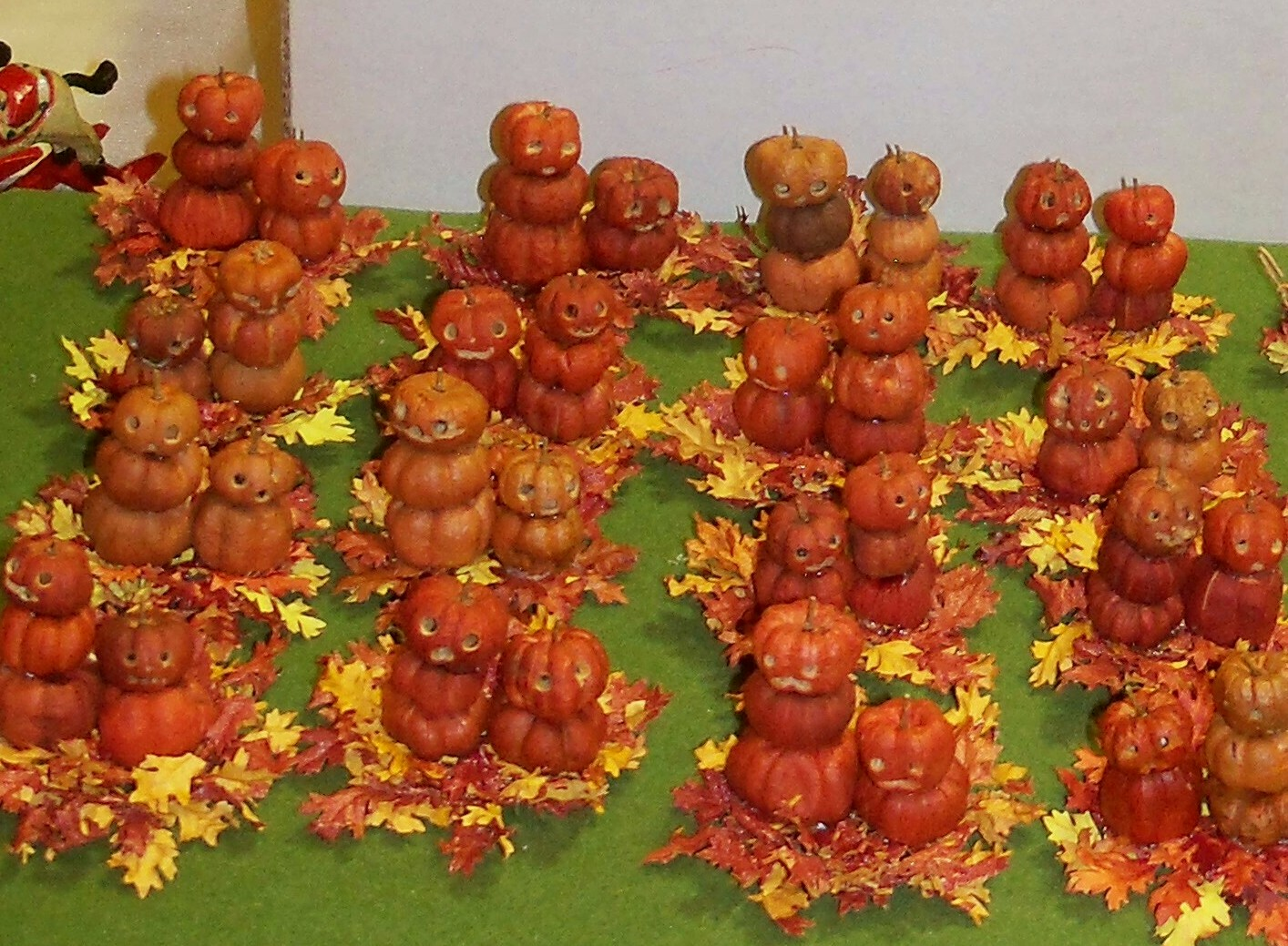 Pumpkin people on fall leaves