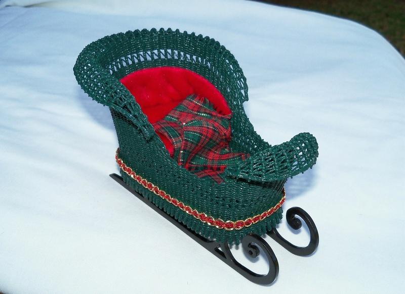 Green wicker sleigh