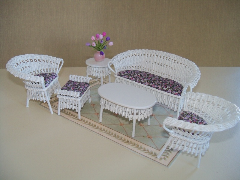 White wicker with purple print cushions